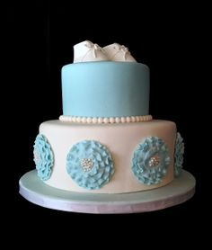 Baby boy shower cake with fondant flowers and gum paste or sugar baby shoes