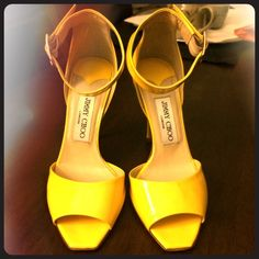 Authentic Jimmy Choo shoes Yellow strappy Jimmy Choo in size 5.5 very elegant and modern wore a few times in great condition. No longer have the box or the carrying cloth. Jimmy Choo Shoes