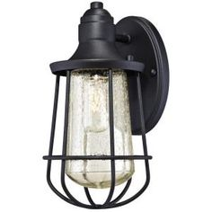 The Westinghouse Elias Outdoor Wall Lantern features a rich textured black finish on durable steel. The clear seeded glass is surrounded by an open metal cage and creates bright light just where you need it. Industrial vintage design adds a classic s Black Outdoor Wall Lights, Outdoor Ceiling Fans, Outdoor Wall Lantern, Outdoor Wall Sconce, Outdoor Wall Lighting, Exterior Lighting, Outdoor Walls, Wall Sconce Lighting, Wall Sconces