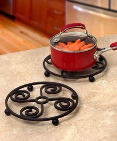 Replace your old pot holders with this stylish and sturdy Scroll Square Trivet from Spectrum. This steel trivet features a raised base that is perfect for protecting your countertops and tables from hot plates, pans, dishes, and more. Cool Kitchen Gadgets, Kitchen Items, Cool Kitchens, Kitchen Decor, Iron Furniture, Steel Furniture, Home Decor Furniture, Wrought Iron Decor, Wrought Iron Gates