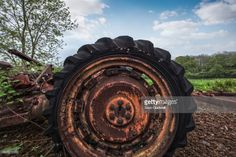 Broken tractor wheel with tire