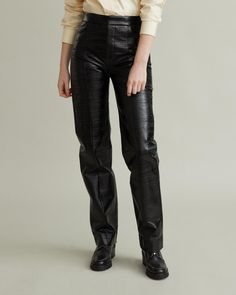 Olbia is a pair of lacquer trousers with a shiny finish, featuring two pockets at front and decorative seams cutting vertically down both legs. Apothecary, Size Model, Designing Women, Leather Pants, Trousers, Pairs, Pockets, Legs, Cotton