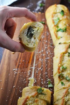 Spinach and Artichoke Dip Stuffed Garlic Bread. This is everything you've ever wanted in an appetizer and more.   hostthetoast.com