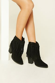 e6070206e4a9 A pair of faux suede boots with knotted fringe