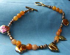 Check out Beaded bracelet, bead bracelet, wire bracelet, Fall bracelet, leaf bracelet, leaf charm, charm bracelet, jasper stone bracelet on doubledzbeadz