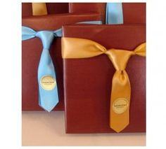 A Father's Day gift can be presented in a simple and masculine package such as a Shirt and Tie gift bag. The gift bag template is available for free at Papercrave.com and is suitable for small gifts such as sports tickets, watches or electronic gadgets. Larger gift can be presented in a package wrapped in solid colored paper, and a piece of ribbon tied around it like a necktie. Personalize the package with his favorite colors and a cute gift tag.