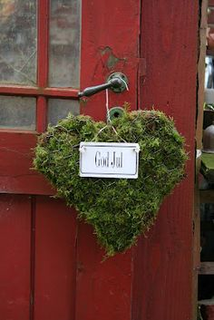 A primitive, moss wreath graces a weathered & worn, red door ... Lovely!
