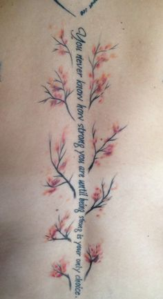 Spine quote with cherry blossoms. You never know how strong you are until being strong is your only choice.