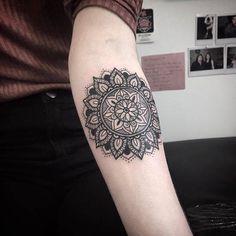 Mandala tattoo on Amy's left inner forearm.
