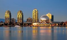 Vancouver City, Downtown, Science World museum, Vancouver Harbor, night time, The windows of the houses, illuminated by the setting sun, glow orange and this glow is reflected in the mirror water of the bay. • Also buy this artwork on wall prints, apparel, stickers, and more.