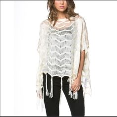 Eyelash poncho top Ivory boho poncho style top with eyelash fringe at the hem. Loose fit, super soft and super chic! The perfect finishing touch for an otherwise basic shirt and jeans outfit or a great festival season piece! Stock photos courtesy of April Spirit.  April Spirit Tops Tees - Short Sleeve