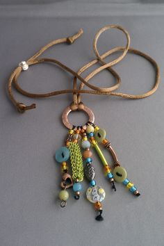Juicy Citrus Tassel Necklace with Copper Ring. Great way to use all those orphan beads.
