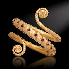 "Kent Raible  Forearm Fandango  Wearable sculpture bracelet in 18K gold and rubies. Can be made to size for forearm or upper arm. Created in 2007 for the AJDC annual theme project ""Spiral"".   Photo: Barry Blau Photography"