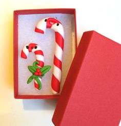 Polymer clay candy cane by #maocreatures https://www.etsy.com/listing/211172491/miniature-two-cute-little-christmas
