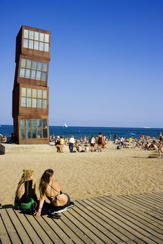 To the south and east, Barcelona's fanciful cityscape—from playful Joan Miró sculptures to Antoni Gaudí's fantastical architectural swirls—meets the Mediterranean Sea. In summer, the city's collective focus shifts coastward to eight white-sand beaches and Places To Travel, Travel Destinations, Places To Go, Barceloneta Beach, By Train, Beach Town, White Sand Beach, Beautiful Places To Visit, Spain Travel