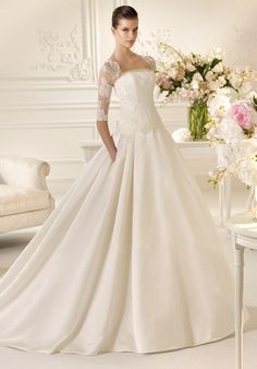 Nelson dress by White One -- strapless ballgown with detachable 3/4 length sleeves with attached chapel train.