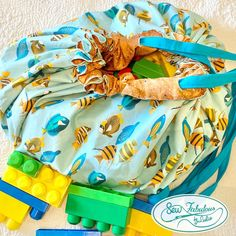 Fun Fish design and LOTS of toy storage all in one!| The drawstring toy bag converts to a play mat for fun at home or on the go| Durable, washable and easy for kids to use!