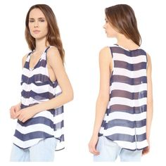 "BB Dakota Striped Tunic Navy blue and white light weight wide striped tunic. Two front pockets and back slit. Semi-sheer, airy and perfect to wear all year long. 100% polyester. Measurements: 18"" Chest from left to right armhole/ 28""  Length from top shoulder seam to bottom shirt hem. BB Dakota Tops Tunics"