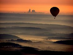 A beautiful aerial view of the illuminated Philadelphia skyline on a morning hot air balloon flight above Chester Springs, PA