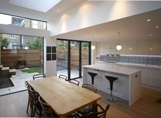 Salcott Road - kitchen / dining area with large areas of glazing and a rooflight over the dining area Kitchen Diner Extension, Open Plan Kitchen, New Kitchen, Kitchen Decor, Kitchen Ideas, Kitchen Island, Clerestory Windows, House Extensions, Kitchen Extensions