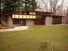Unique in more ways than one, the Louis Penfield house, Willoughby, Ohio, built in 1955 :: It is a taller than usual Usonian, with taller, narrower windows, and best of all, can be rented by the day so that you can experience living in a FLW Usonian home...