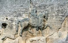 Madara Rider: The Mysterious Stone Horseman of Bulgaria-The Madara Rider sits 246 feet above ground, on a cliff face in the Madara Plateau of northeastern Bulgaria. The relief is inaccessible, adding to its mystery. How were they able to create it?   Including the inscription in Medieval Greek, the rider covers close to 1400 square feet on a vertical 328 foot cliff face. The horseman is depicted in a hunting scene, spearing a lion. The lion is being trampled by the horse and a dog is…