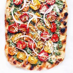 Grilled Pizza With Pesto And Roasted Tomatoes via @feedfeed on https://thefeedfeed.com/lastingredient/grilled-pizza-with-pesto-and-roasted-tomatoes