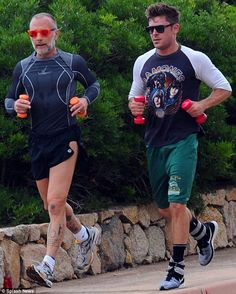 Workout buddies! Zac Efron, 26, was pictured getting a cardio session in alongside pal Gianluca Vacchi at the seaside resort of Porto Cervo in Sardinia on Saturday