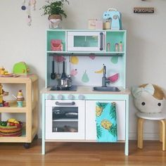 Play Kitchen Inspiration: Peachy Parade's Ikea Hack: I love the mint - and also the interesting choices of what to paint & what to leave white/wood.