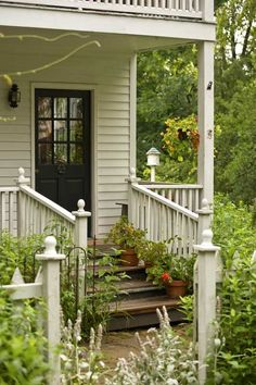 Pots on porch steps and a hanging basket of nasturtiums...