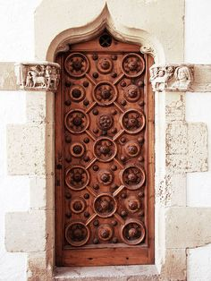 Ornate Wooden Door, Sitges  A door outside Palau Maricel, Sitges, Spain.