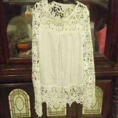 White blouse with floral lace Size Large but runs as a small or medium. The blouse is a bit transparent and has floral lace in the top and sleeves. Tops Blouses