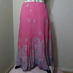 Vintage Pink Paisley Flowing Silk Skirt A lovely skirt with a primary color of pink and paisley and floral designs in silver, blue, purple, and yellow. A zipper runs down the left side and it has a handkerchief style hem.  It comes down to about the ankle. Well loved in great condition. Shell 100% Silk, Lining 100% Polyester. Made in China. Telluride Clothing Co. Brand. Vintage Skirts Maxi