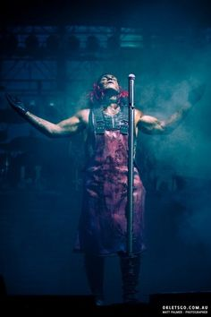 Till Lindemann on stage performing Rammlied