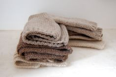 a sweet little stack of baby woolens.