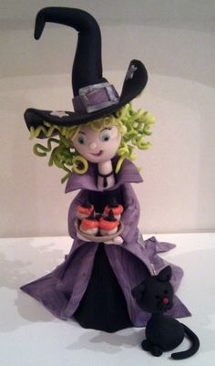 'Millie' the gum paste witch.  She and the cat are perfect together.  I wonder if i could do her justice.
