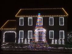 Two houses are included in the display, which is set to the song from Frozen.
