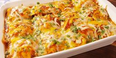 Easy Chicken Enchilada Recipe - How to Make Best Chicken Enchiladas - Delish.com