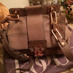 AUTHENTIC KOOBA CROSS-BODY BAG A unique look for Kooba handbags in taupe leather two tones with Rose gold accessories very cute has a zipper on the inside and room for lots of things. The strap is adjustable. The purse is in gently used condition and also comes with a dust bag. Beautiful adjustable Cross-body strap Kooba Bags