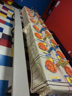 Golden State Warriors kid's table setting. Basketball court table cloth and decorations came from Party City online