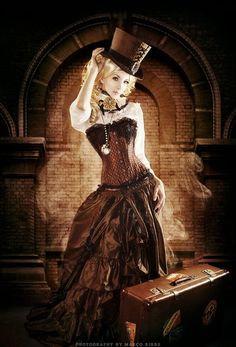 Steampunk fashion in shades of sepia.  Top hat, Victorian ruffles, & clock work jewelry. Futuristic yet so many elements from a era of classic beauty. Photography by Marco Ribbe