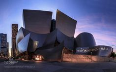 Walt Disney Concert Hall - Pinned by Mak Khalaf Walt Disney Concert Hall Downtown LA. This is a very original and building in downtown LA I had fun shooting it. I ran to not miss the details in the sky and it was right before blue hour. City and Architecture skysunsettravelcityscapeMonumentdowntown LAWalt Disney Concert Hall by RamelliSerge