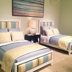 Great beachy colors on these upholstered beds, and I like that they are different from your usual upholstered bed (great wood frame & an upholstered footboard too)