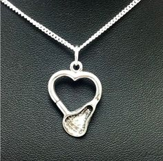 Pewter Lacrosse Stick Shaped Heart from danahoiles.com Only $12.95