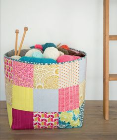 Looking for a stylish storage solution? We love this colorful Nine Patch Fabric Basket by Liz Evans and Elizabeth Evans. Find the pattern in their book, The Simple Simon Guide to Patchwork Quilting.