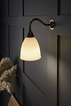 The white ceramic wall light is a truly unique light, handcrafted by the UK 's leading artisan ceramic manufacturers. These stunning ceramic shades have intricate ribbing and edging like no other wall lighting we have seen. If you are looking for statement interior design lighting then look no further. Made from natural material, the light is diffused beautifully through the ceramic shade. Neutral colours and various finish options ensures there will be a combination to complement any space. Unique Lighting, Wall Lighting, Interior Wall Lights, Ceramic Manufacturer, Ceramic Wall Lights, Fashion Lighting, White Porcelain, White Ceramics, Wall Sconces