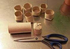"""Seed pots from toilet rolls. Clever! translation of how to :: Cut toilet roll in two. Cut 4 sections at one end and fold as shown. Fill the earth and sow a seed. It might be nice to have """"pot"""" on a plate or platter because they leak a little soil in the bottom."""