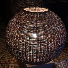 Magdalena Godawa uses sheets and sheets of newspaper to create paper basket lampshades. These beautiful woven lampshades were created to ord...