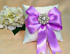 Orchid Ring Pillow  Ivory Ring Pillow  White by A Priceless Princess....pillows are available in white or ivory and 30 satin ribbon bow colors.  Use PIN10 for 10% at https://www.etsy.com/listing/399565085/orchid-ring-pillow-ivory-ring-pillow