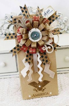 This has to be the prettiest bow and gift packaging in Americana style that I have ever seen.  Created by Melissa Phillips for Papertrey Ink's tips and tricks.  This woman is amazing!